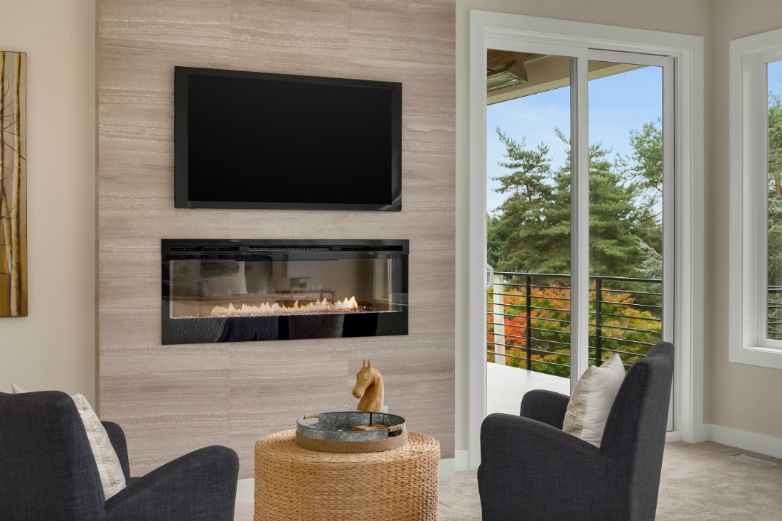 tv-moutned-above-gas-fireplace-glass-living-room