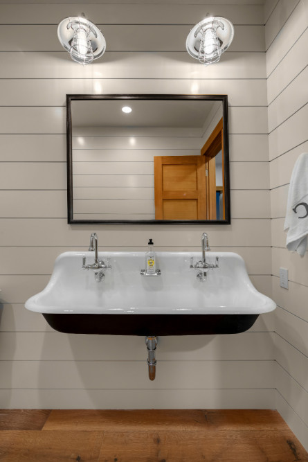 large-porcelin-sink-dual-faucets-shiplap-walls