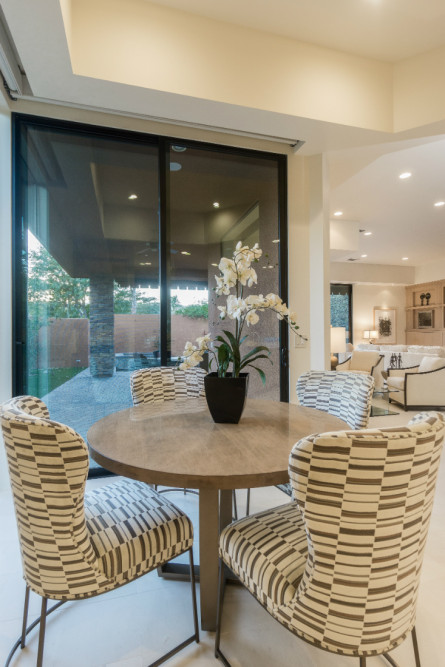 small-dining-table-upholstered-chairs-cream-and-gray