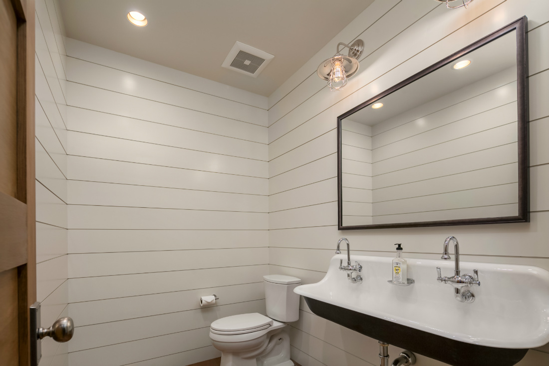 white-shiplap-wall-bathroom-large-mirror-dual-sinks-stainless-hardware